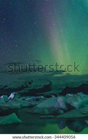 Northern lights over ice lagoon, Iceland - stock photo