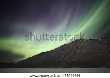 Northern Lights over Mirror Lake in Alaska - stock photo