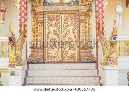 Northern Thai style Buddhist church door in Wat Phra That Doi Suthep, Chiang Mai province, Thailand - stock photo