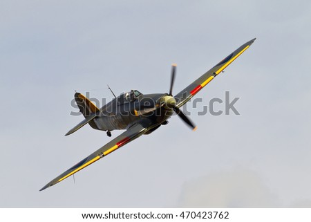 NORTHILL, UK - OCTOBER 10: A vintage sea Hurricane fighter aircraft from WW2 banks right in preparation to land at the Old Warden aerodrome on October 10, 2014 in Northill.
