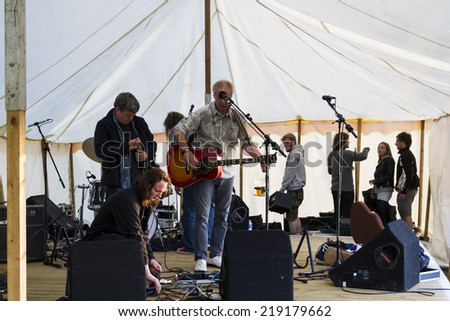 NORTHUMBERLAND, ENGLAND, AUGUST 30, 2014. Singer, songwriter, Steve Daggett, original member of band, Lindisfarne, performs at fund raising event. August 30, 2014, Northumberland, England, UK.