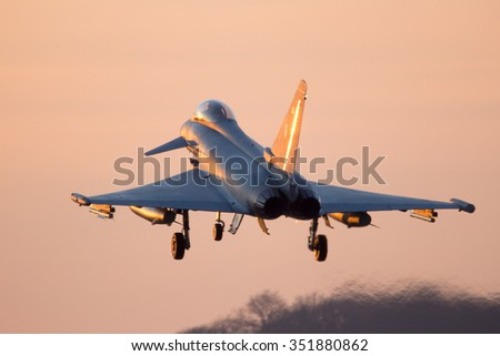 NORVENICH, GERMANY: DEC 14, 2015: German Air Force Eurofighter Typhoon fighter jet from Tactical Wing 31 landing at sunset. The Eurofighter Typhoon replaced the Tornado airplanes in 2009.