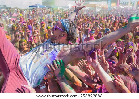 Norwalk, California, USA - March 7, 2015: Man in the arms of the crowd during the Holi Festival of Colors