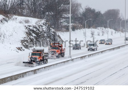 NORWALK,CT - JANUARY 27:  Plow truck on I-95 after winter storm in Norwalk on January 27, 2015 - stock photo