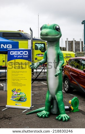 NORWALK, CT - SEPTEMBER 21: Gecko figure representing Geico  insurance at Norwalk boat show in September 21, 2014 in Norwalk, CT. - stock photo
