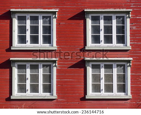 Norway architecture detail, window in red wooden walls.