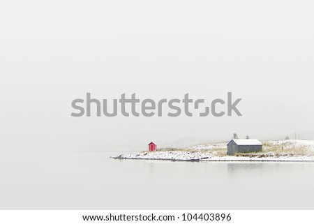 Norway Cottage on winter coast - stock photo