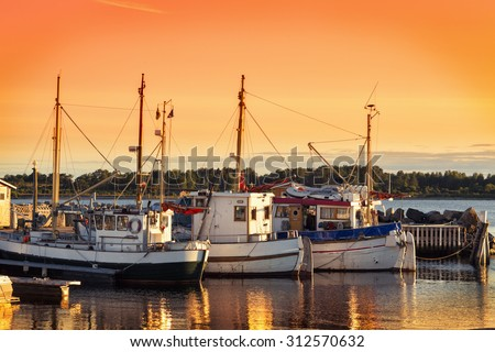 Norway Fishing Boat And Pier At Dusk - stock photo