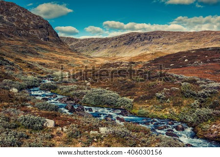 Norway high mountain landscape with river. Autumn film style colors. - stock photo