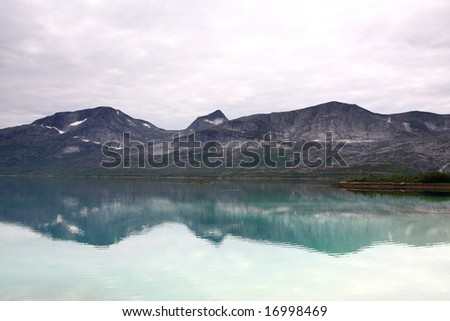 Norway landscape, fjord and mountains in the background