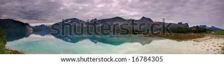Norway landscape panorama, fjord and mountains in the background - stock photo