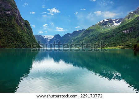 Norway mountain lake Oldenvatnet with the glacier Briksdal
