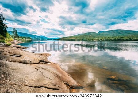 Norway Nature, Autumn Time. Cloudy Day, Landscape With Mountain, Pure Water Lake, Pond, Sea - stock photo