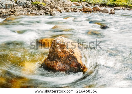 Norway Nature River. Rock Stone In Pure Cold Water Pond - stock photo