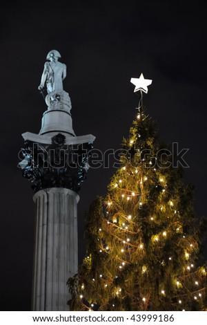 Norwegian Christmas Tree, Trafalgar Square, London, England, UK, Europe, with Nelson's Column in the background - stock photo