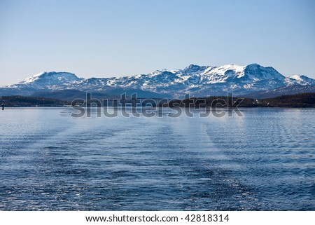 Norwegian coast landscape with snow on the mountain