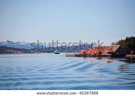 Norwegian fishing village at the coast - stock photo