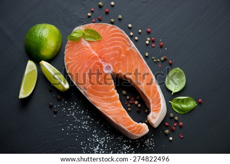 Norwegian salmon filet with pepper, sea salt, green basil and lime - stock photo