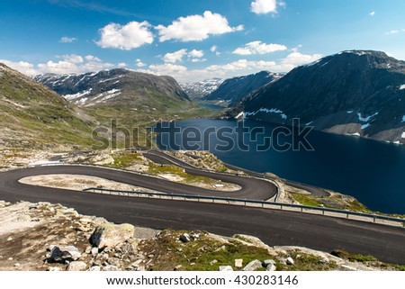 Norwegian serpentine road. The road is so narrow that disperse colliding buses almost impossible - stock photo