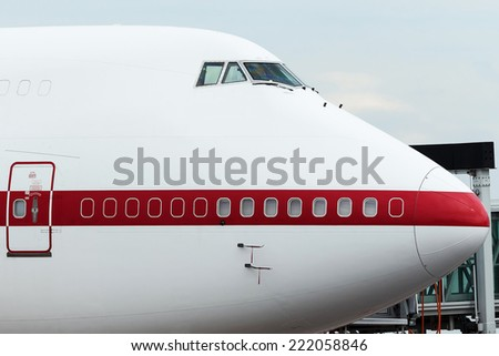 Nose of Jumbo Jet at the gate - stock photo
