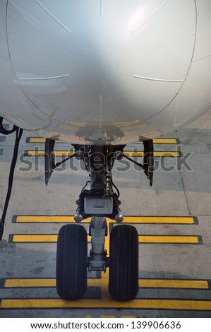 Nose wheel on commercial airliner - stock photo