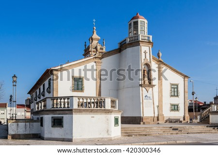 Nossa Senhora da Lapa church in Povoa de Varzim, Portugal. The place where the many local fishermen or families seek help in times of danger. It includes a lighthouse in the structure. - stock photo