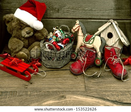 nostalgic christmas decoration with antique toys over wooden background. retro style picture - stock photo