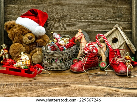 nostalgic christmas decorations with antique toys over wooden background. retro style toned picture - stock photo