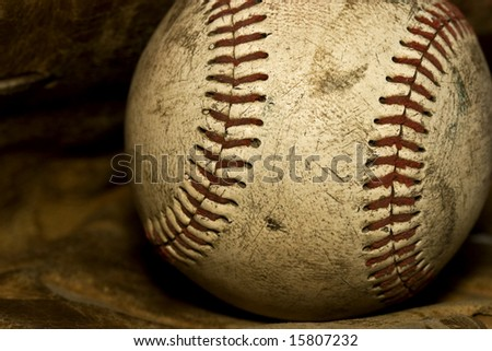 Nostalgic close up of a old baseball that has seen its days.