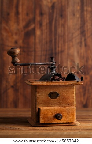 Nostalgic coffee grinder with Ground Coffee  and Whole Coffee Beans