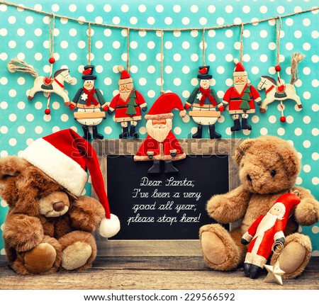 nostalgic home christmas decoration with antique toys. blackboard with sample text Dear Santa. retro style toned picture - stock photo