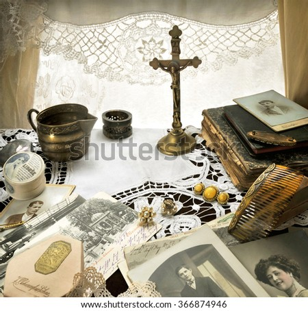 Nostalgic Reminiscence -  Still Life with Antique Crucifix And Other Ladies Accessories One Hundred Years Ago - stock photo