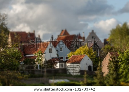 Nostalgic Town in the Netherlands surrounded by bushes. - stock photo