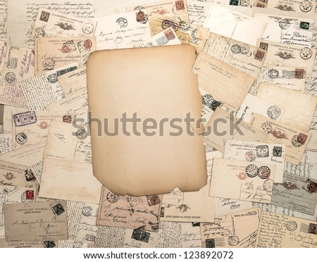 nostalgic vintage background with old handwritten post cards and grungy paper sheet - stock photo
