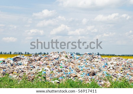 Not resolved dump of dust on the nature near a field - stock photo