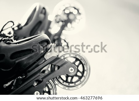 Not the color image of wheels of roller skates closeup.