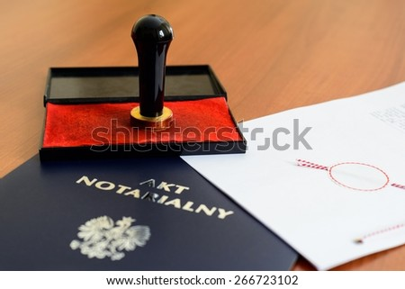 Notarial act and stamp used by the notary - stock photo