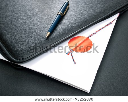Notary certified agreement in an open folder for documents. - stock photo