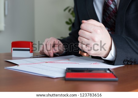 Notary Public stamping a certified copy in his office - stock photo