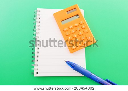 Note and calculator - stock photo