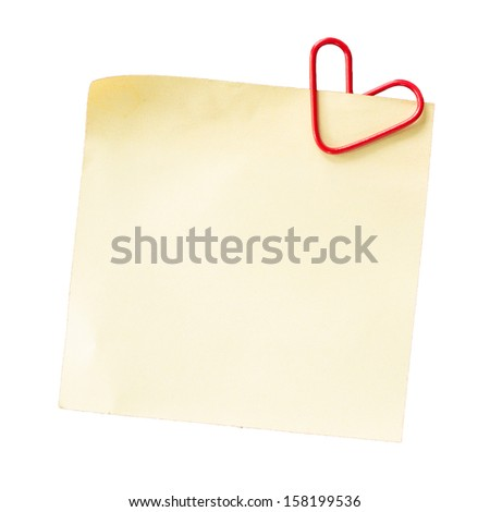 Note and heart shaped paper clip on a white background - stock photo