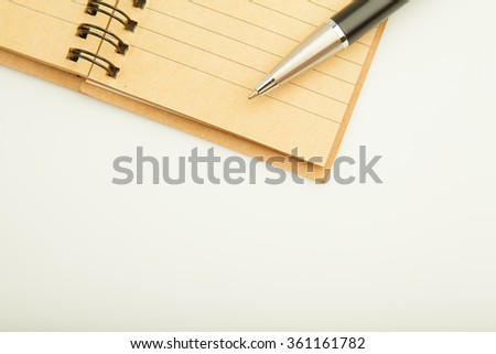 Note and Pen with isolate background, - stock photo