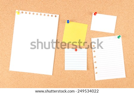 note and push pin isolated on cork board ready for your text. - stock photo