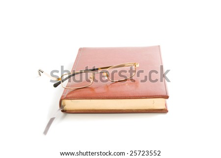 note book and glasses isolated on white