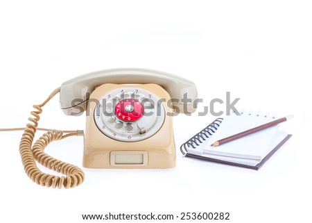 Note Book Binder and pencils ready for important notes. Placed by telephone, antique - stock photo