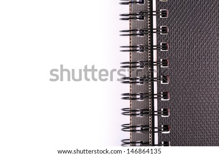 Note book for taking notes with a pen isolated on white