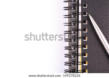 Note book for taking notes with a pen isolated on white - stock photo
