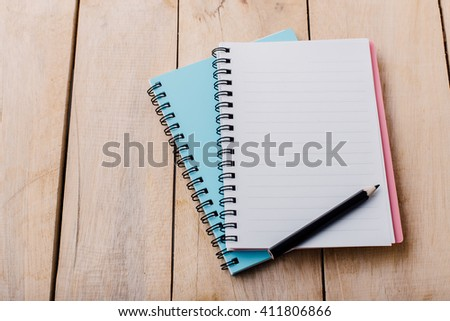 note book on wooden table