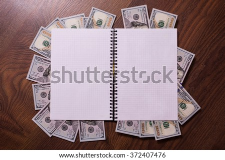 note book page and money, a place for records, business plan, money background, background of dollars, copyspace, programmer, earnings on the Internet,  the money from the book, payment writer  - stock photo