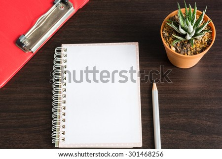 Note book paper empty with pencil and haworthia fasciata(Willd.) on wood table - Creativity crisis concept - stock photo